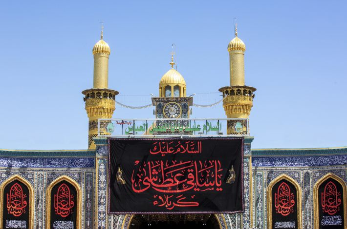 The holy shrine of Aba al-Fadl al-Abbas (peace be upon him) is covered with black banners to declare the Ashura mourning.